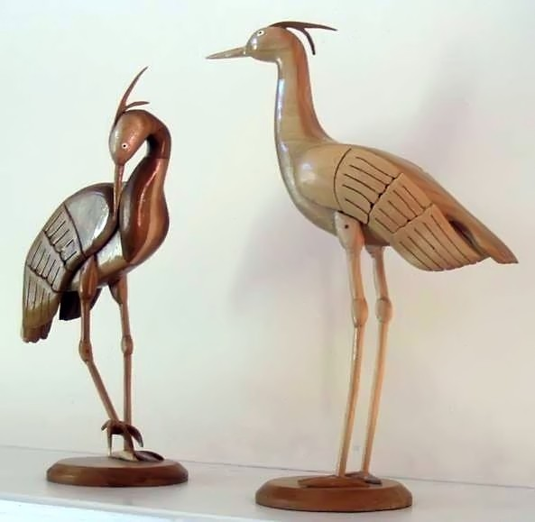 Carved wooden cranes