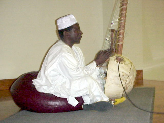 Mandinka Griot Al-Haji Papa Susso performing songs from the oral tradition of the Gambia on the kora