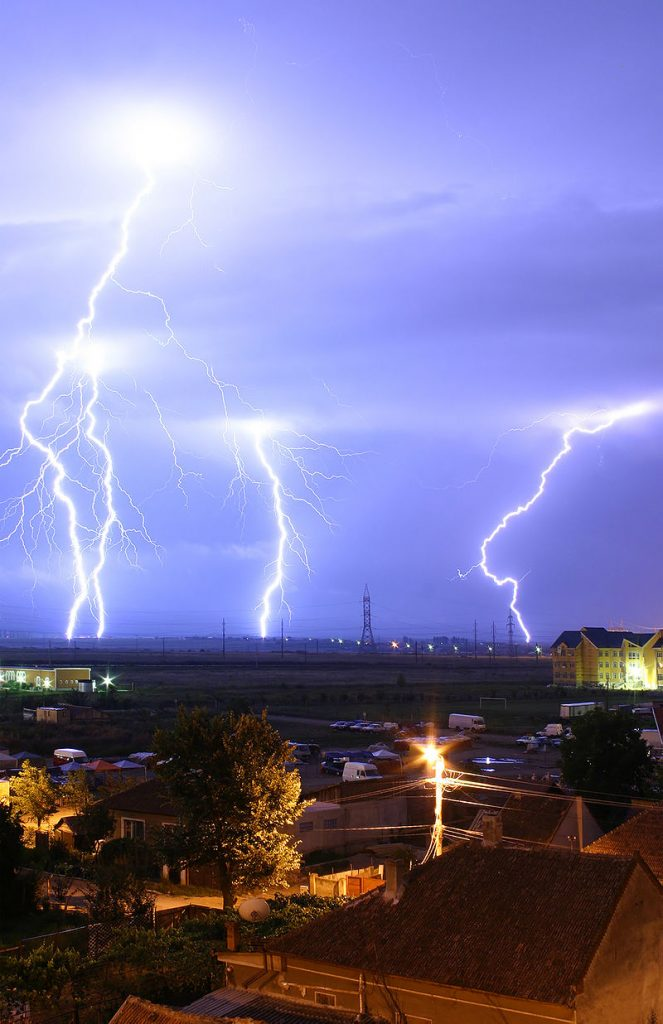Strokes of cloud-to-ground lightning during a thunderstorm