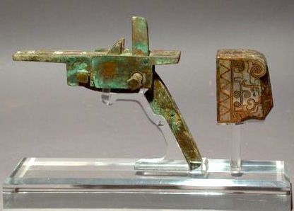 A bronze crossbow trigger mechanism