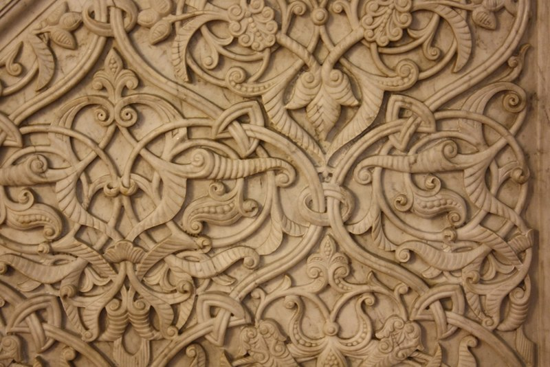 Stone relief with arabesques of tendrils